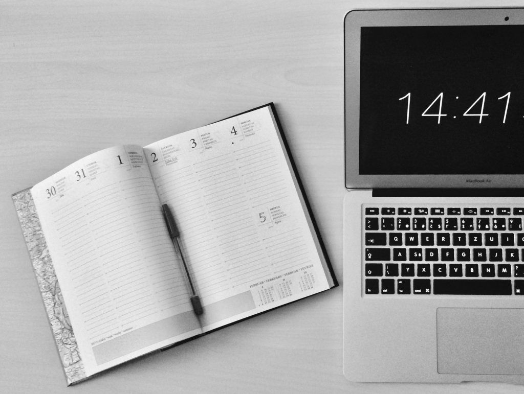 black and white diary with apple product